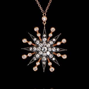 Μενταγιόν αστέρι σε ροζ χρυσό 18Κ με διαμάντια.